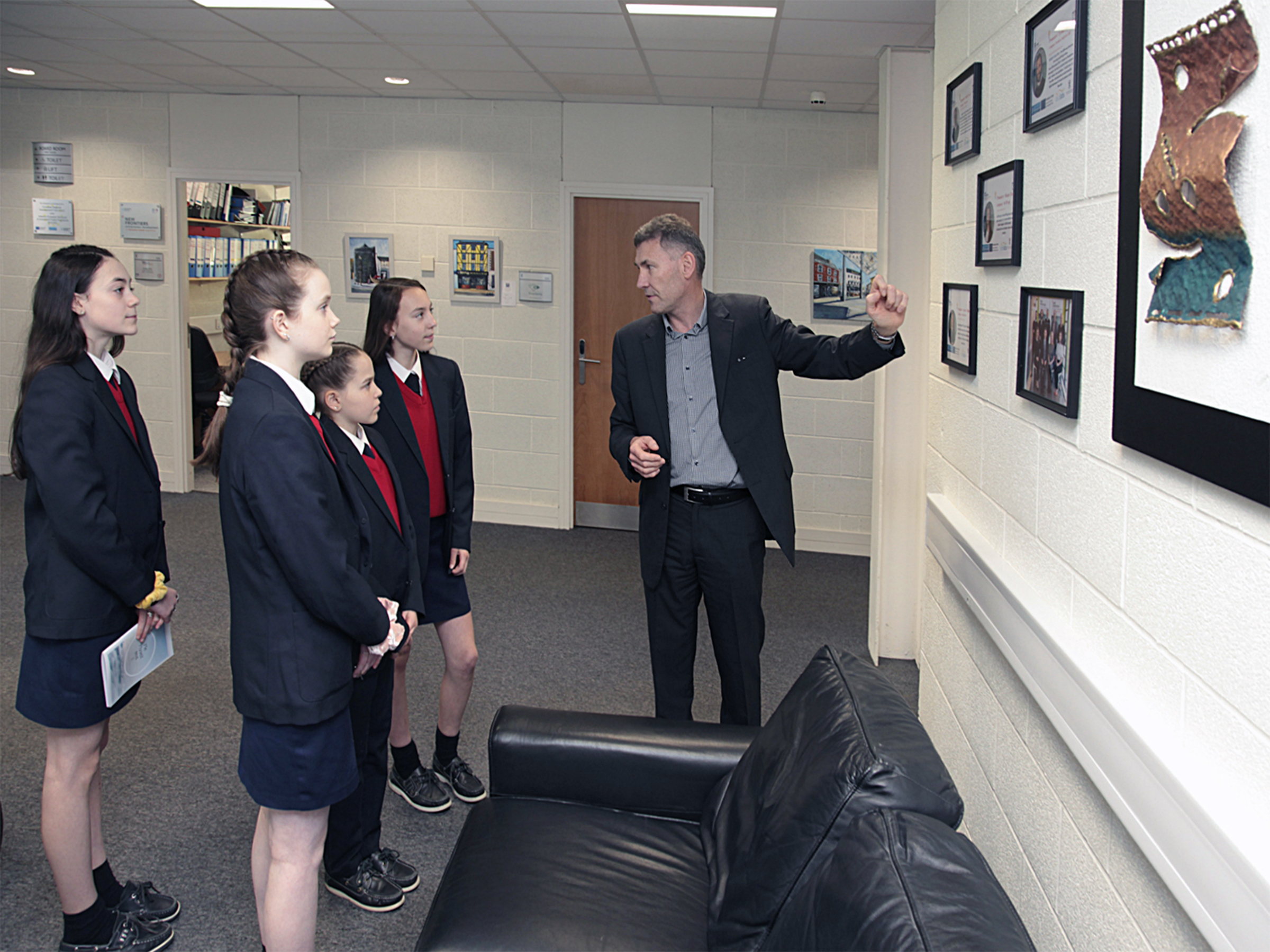 Manager of the Enterprise Ireland New Frontiers Programme Dr Eugene Crehan shows the young entrepreneurs current New Frontiers participants during a tour of ArcLabs
