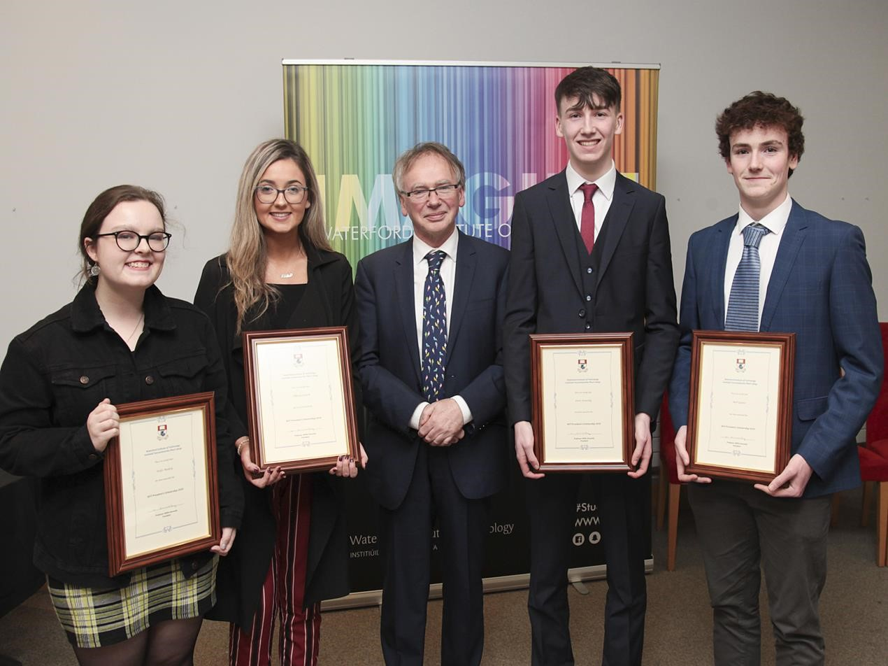 From Left: Aoife Molloy, New Ross Co. Wexford; Olivia Cusack, Nenagh, Co. Tipperary; WIT President Professor Willie Donnelly; Leon Keating, Waterford & Neil Quinn, Waterford; receiving their WIT President's Scholarship Awards for 2019 at a recent ceremony in WIT. Photo George Goulding WIT