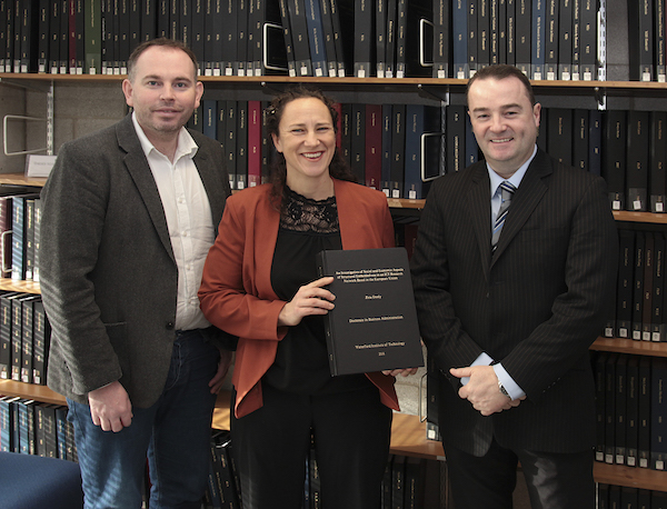 Dr Zeta Dooly (centre) presenting her DBA thesis to WIT Deputy Librarian Kieran Cronin (left) with her supervisor Dr Aidan Duane (right)