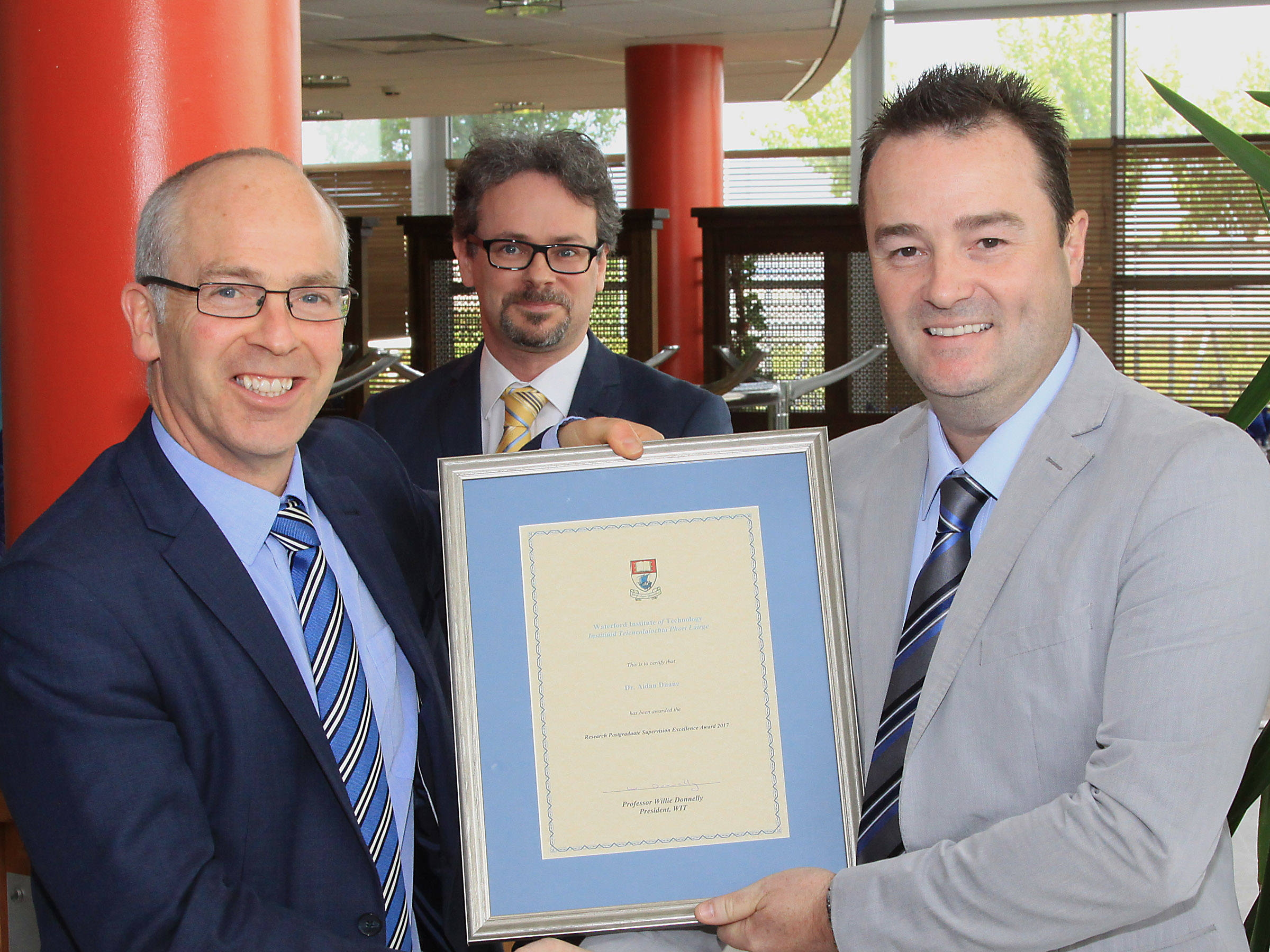Pictured from left are: Dr Peter McLoughlin, Vice President of Research and Innovation and Dr Brendan Jennings, Head of Graduate Studies with Dr Aidan Duane