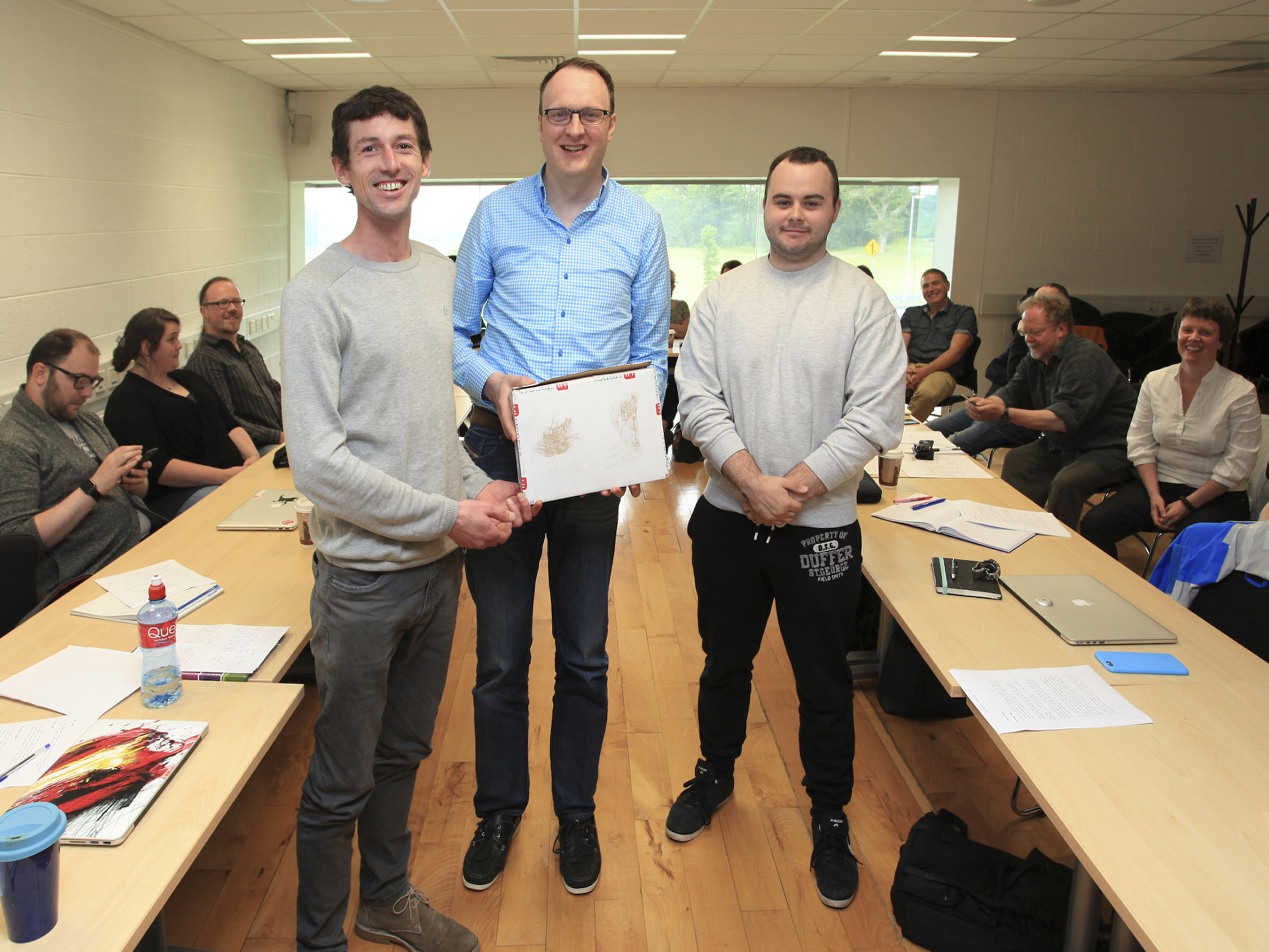 John Julian, Senior Visual Designer at SAP (middle) awarding prize for best project presentation to Visual Communications Students Jim O'Brien (left) and Adam Doyle (right).