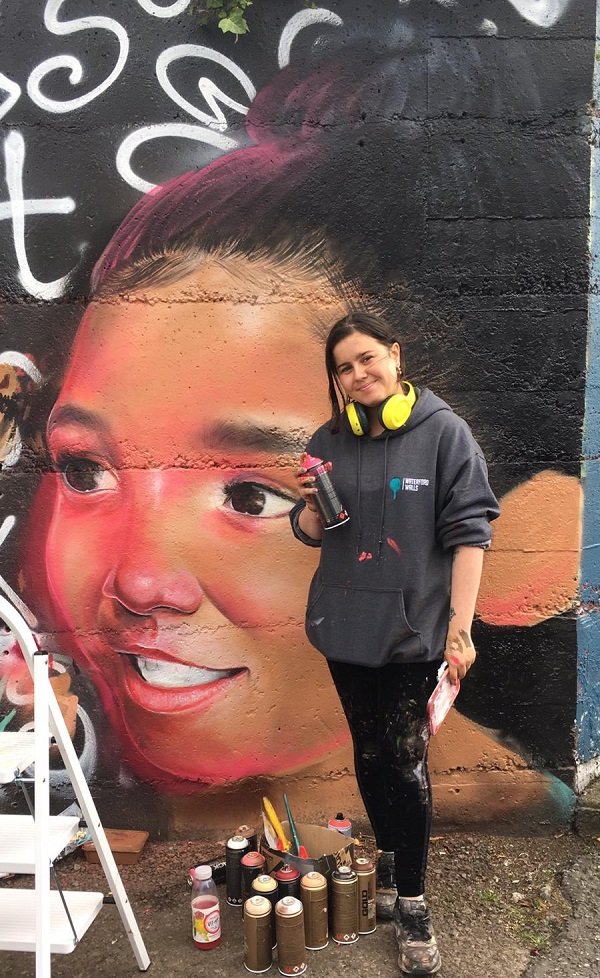 Caoilfhionn Hanton with her portrait for the 2019 Waterford Walls International Street Art Festival