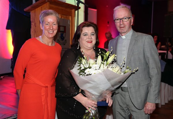 Pictured is Sue Goona (centre) with Head of Careers at WIT, Angela Collins and WIT Chaplain Fr David Keating receiving her Fr John Moore Community Award