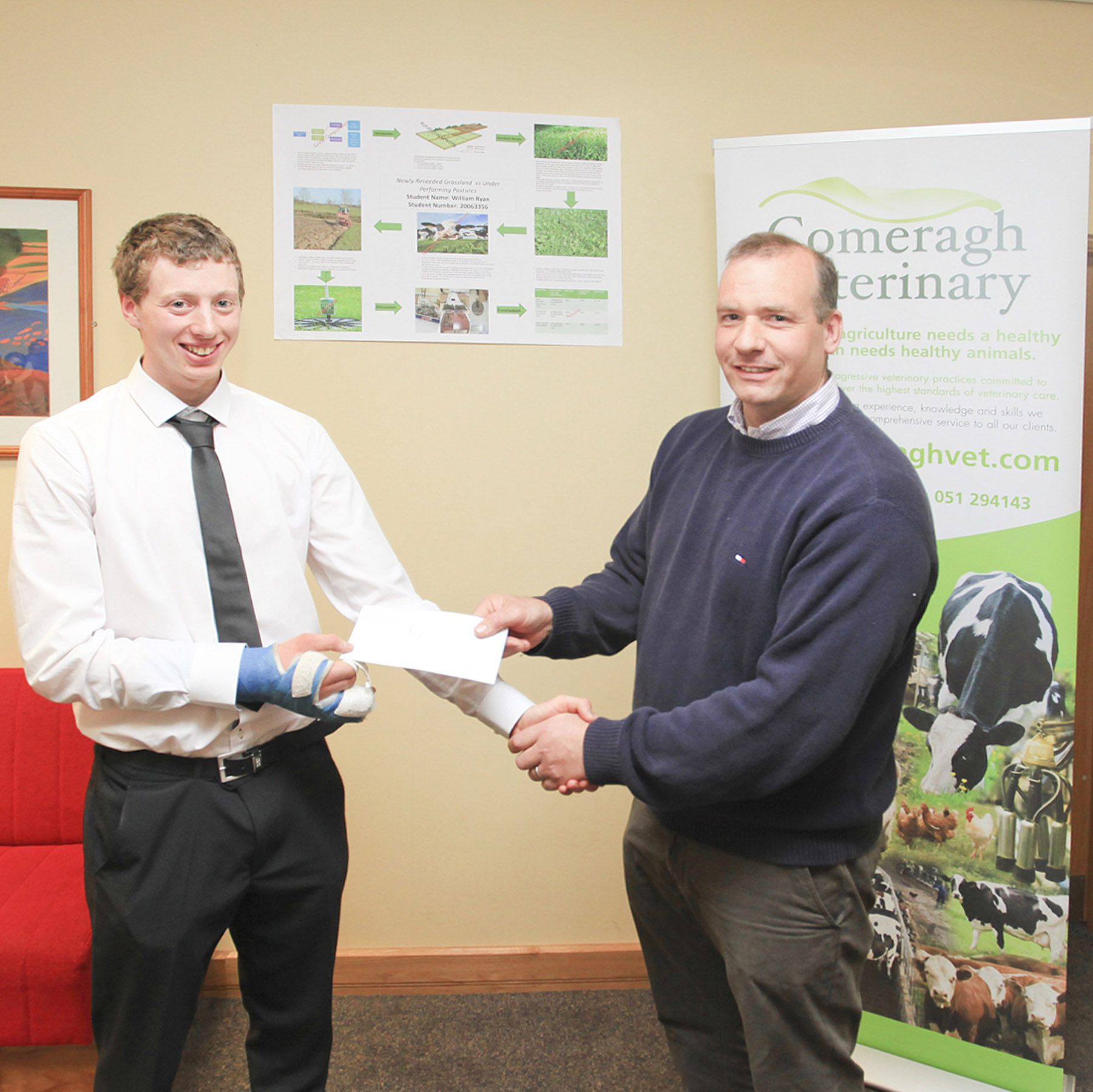 Billy Ryan accepting his award from Comeragh Vets owner, Chris McGrath