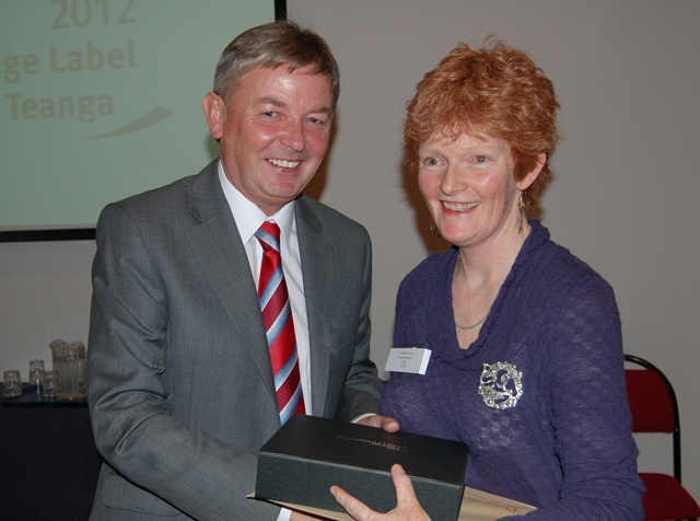 The Language Commissioner, Seán Ó Cuirreáin presenting the 2012 Language Ambassador of the year award to Dr. Fionnuala Kennedy