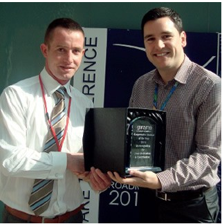 Pictured is Maurice receiving his award from Genzyme
