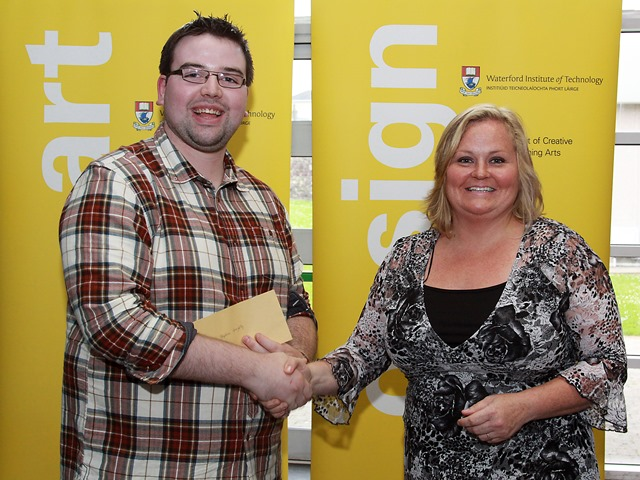 Stephen Geraghty, winning designer and Trudy McIntyre, Chairwoman, Dunmore East FLAG
