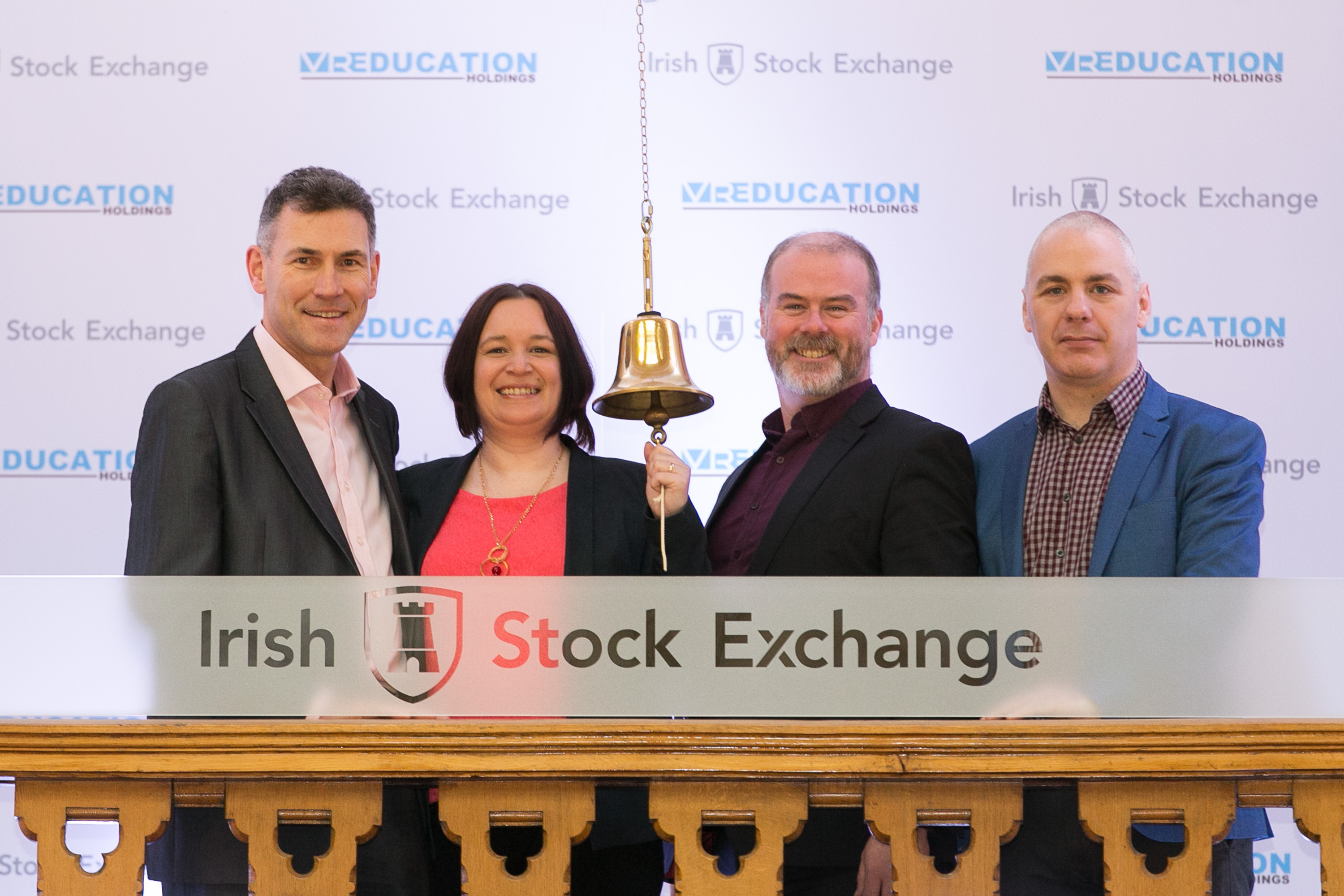 Sandra Whelan Co-founder of Immersive VR Education rings the bell at the Irish Stock Exchange with (L to R)  Eugene Crehan (Director of Programmes CEDRE), Sandra Whelan, Ciaran Cullen (Manager ArcLabs) and David Whelan (CEO and Founder) Immersive VR Education                 (Photograph courtesy of SON Photographic)