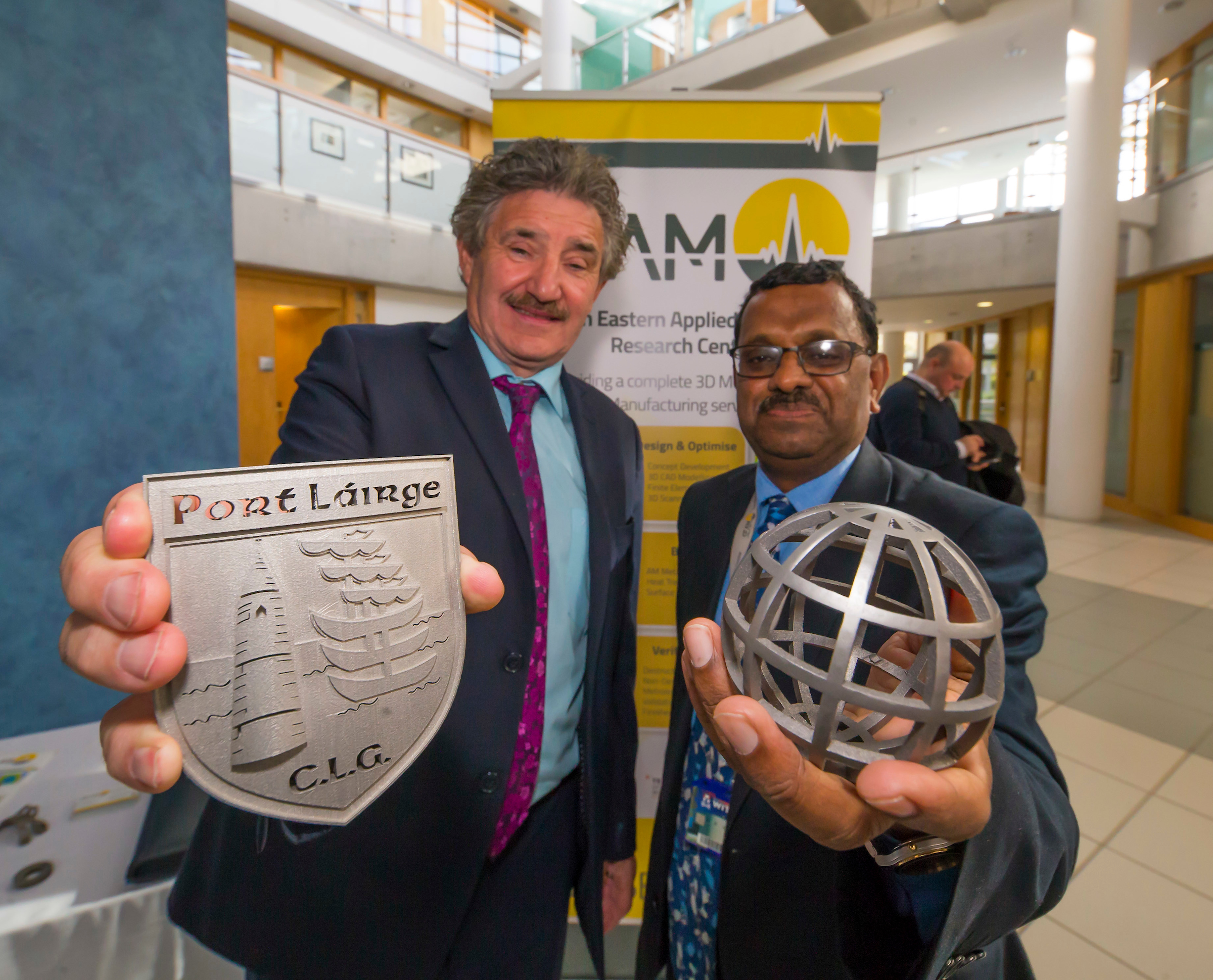 Minister John Halligan TD, Minister of State for Training, Skills, Innovation, Research and Development and WIT's Dr Ramesh Raghavendra, SEAM Centre Director & Technology Gateway Manager with some 3D printed items from SEAM