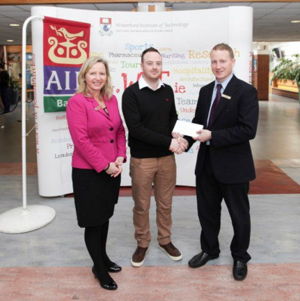 Jonathan O'Donnell accepting his cheque from AIB WIT and AIB Lisduggan branch having won the Solve-It Challenege