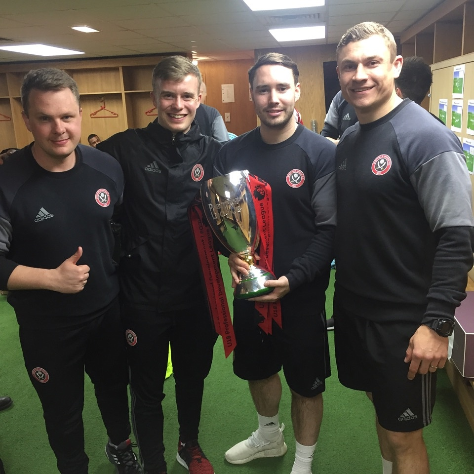 Picture second from the left after winning the league with Sheffield United during his internship in 2017 is Michael.