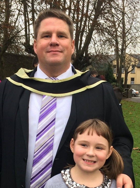 Patrick with his daughter at conferring.