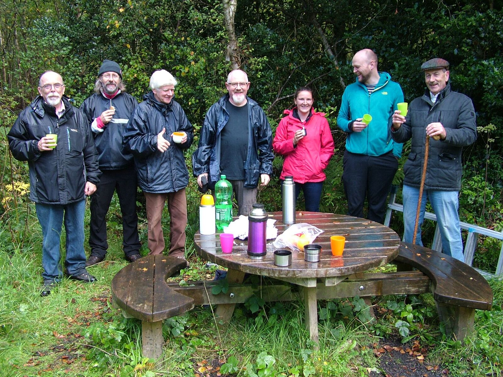 The pine marten den box team having a wet lunch on Abbeyleix Bog. From left to right: Dominic Kessie (Portlaoise Men's Shed), Euge O'Brien (Abbeyleix Bog Project), Hugh Shepard (Abbeyleix Bog Project), Ray Harte (Portlaoise Men's Shed), Denise O'Meara (Waterford Institute of Technology), David Tosh (Ecologist), Joe Grant (Portlaoise Men's Shed).