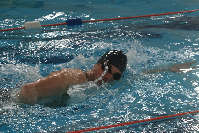 Aubrey Storey, lecturer in the Department of Health, Sport & Exercise Science, competing in the swim leg