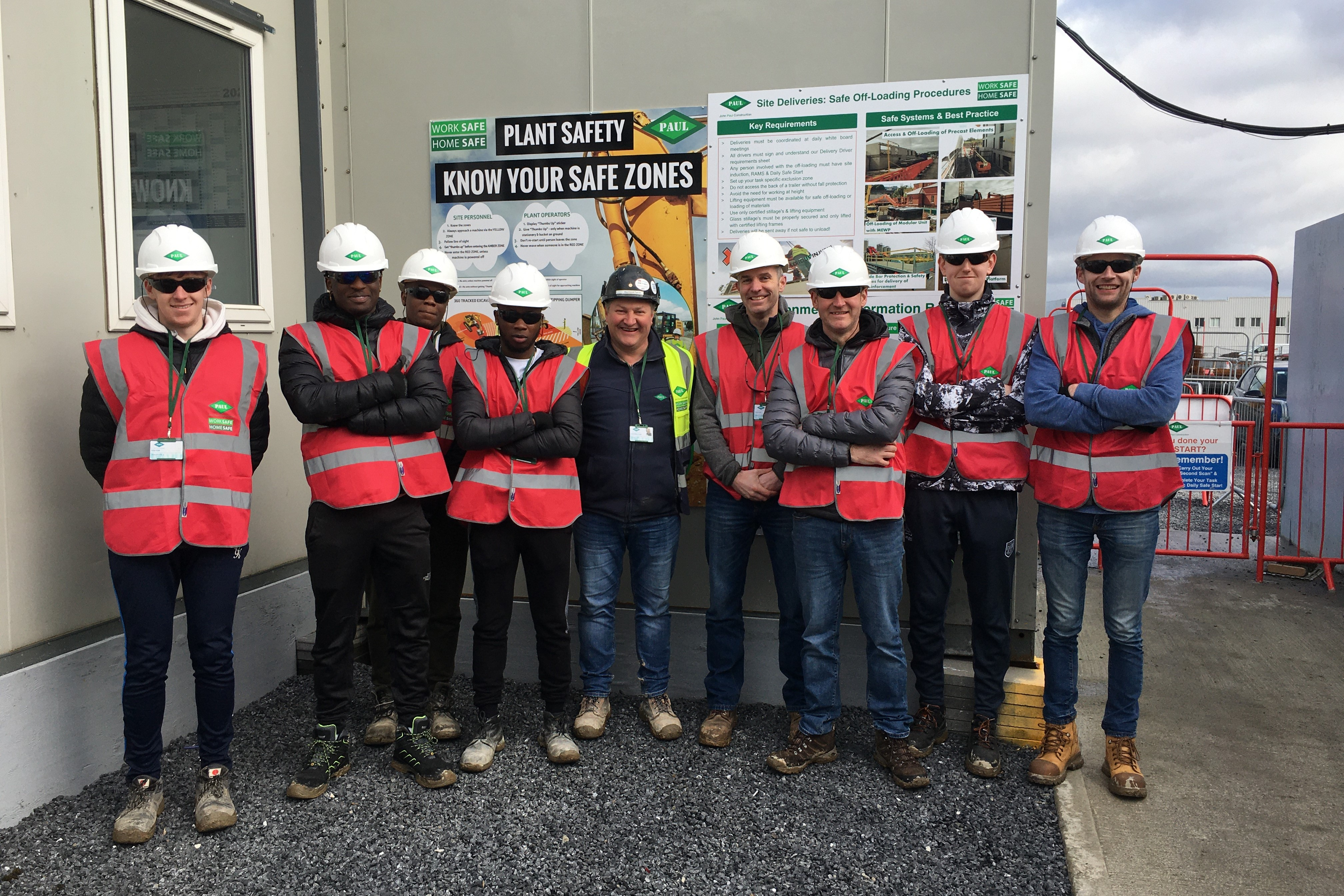 Staff and students from the Department of the Built Environment with John Paul's Site Manager Ray Farrell