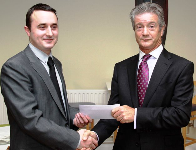 (l-r): Mr Adam Duggan,WIT, being presented with his prize by Donal O'Connell, Partner at Nolan, Farrell & Goff