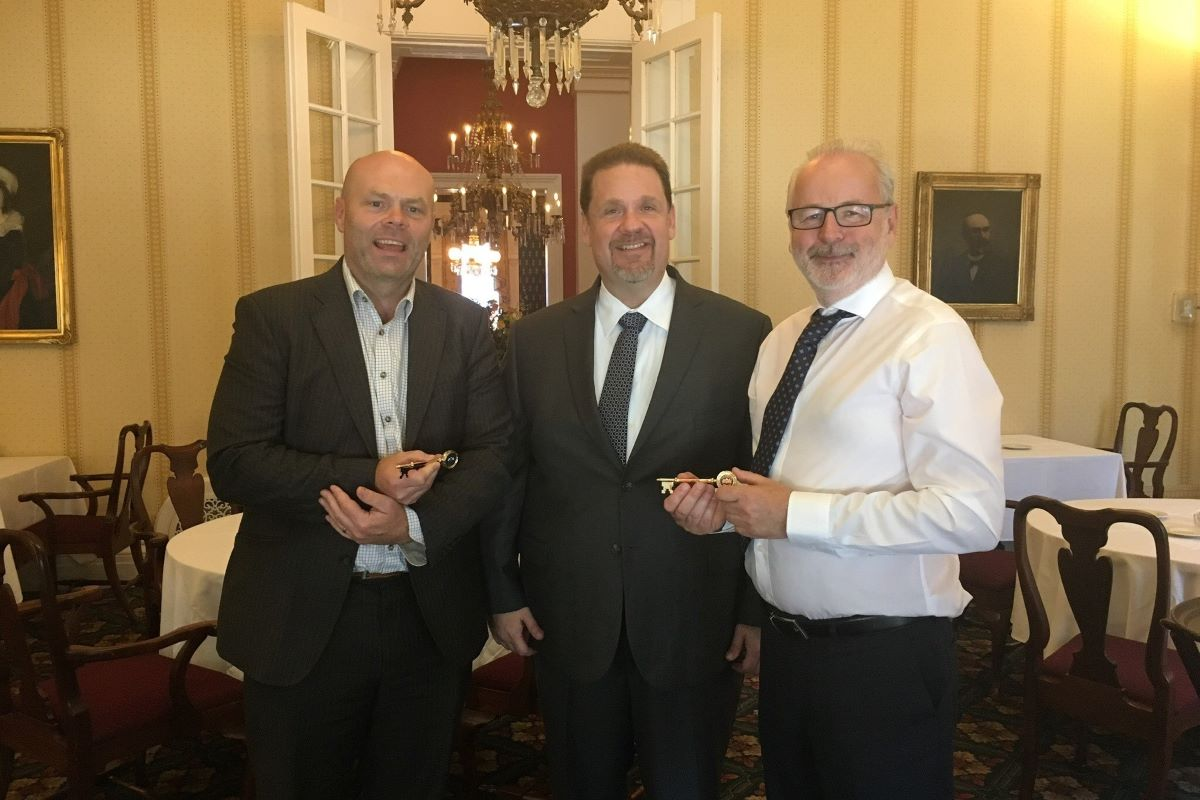 Mr Karl Sanchack CEO of Erie Innovation District congratulating Dr Mark White (R) and Mr Brian Foley (L) on their presentation of the keys of the city by Mayor Joe Schember